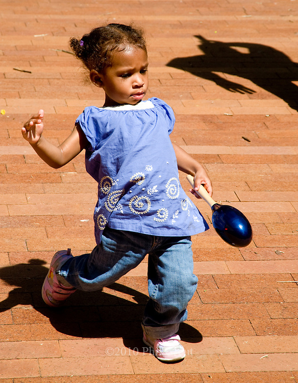 """Photo by Phil Grout..Payton Jackson, 15 months of Baltimore, puts a little more """"funk"""".in her moves as she works the marracas and jives to the music.at the Fair in the Square."""