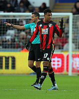 Joshua King of Bournemouth (R) celebrates his opening goal during the Barclays Premier League match between Swansea City and Bournemouth at the Liberty Stadium, Swansea on November 21 2015