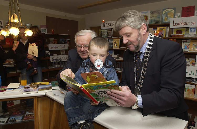 With Press release (Hard Copy)....At the official opening of the Siopa leabhar in Barrack street, Ennis, were, Sean O Ceallaigh, young  Diarmuid O Ceallaigh and Mayor of Ennis, Tommy Brennan. Photograph by John kelly.