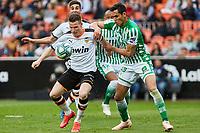 29th February 2020; Mestalla, Valencia, Spain; La Liga Football,Valencia versus Real Betis; Kevin Gameiro of Valencia CF holds off the challenge from Aissa Mandi of Real Betis