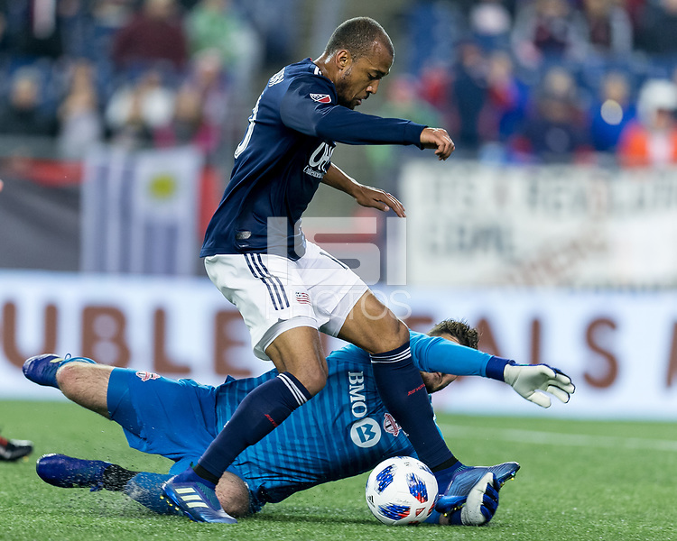 Foxborough, Massachusetts - May 12, 2018: First half action. In a Major League Soccer (MLS) match, New England Revolution (blue/white) vs Toronto FC (red), at Gillette Stadium.