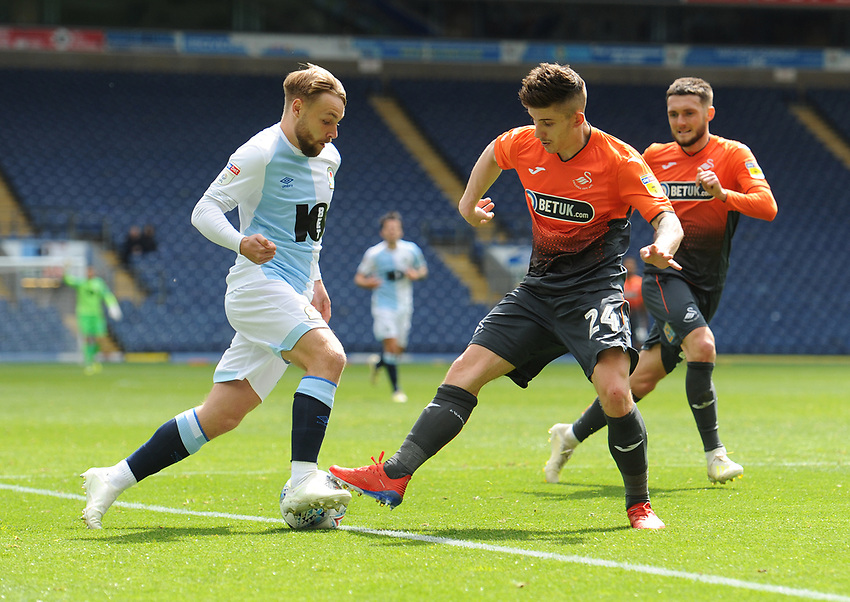 Blackburn Rovers' Harry Chapman under pressure from Swansea City's Declan John<br /> <br /> Photographer Kevin Barnes/CameraSport<br /> <br /> The EFL Sky Bet Championship - Blackburn Rovers v Swansea City - Sunday 5th May 2019 - Ewood Park - Blackburn<br /> <br /> World Copyright © 2019 CameraSport. All rights reserved. 43 Linden Ave. Countesthorpe. Leicester. England. LE8 5PG - Tel: +44 (0) 116 277 4147 - admin@camerasport.com - www.camerasport.com