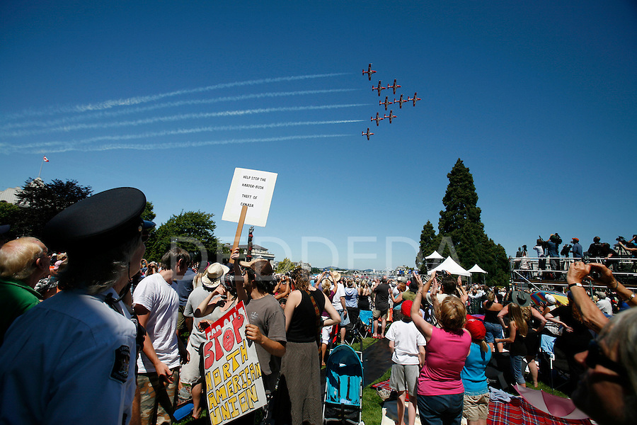 Snowbirds fly over the crowd after remarks by Prime Minister Stephen Harper at British Columbia's 150th Anniversary Celebration at the BC Legislature in Victoria, British Columbia. Photo assignment for Canadian Press (CP) news wire service.
