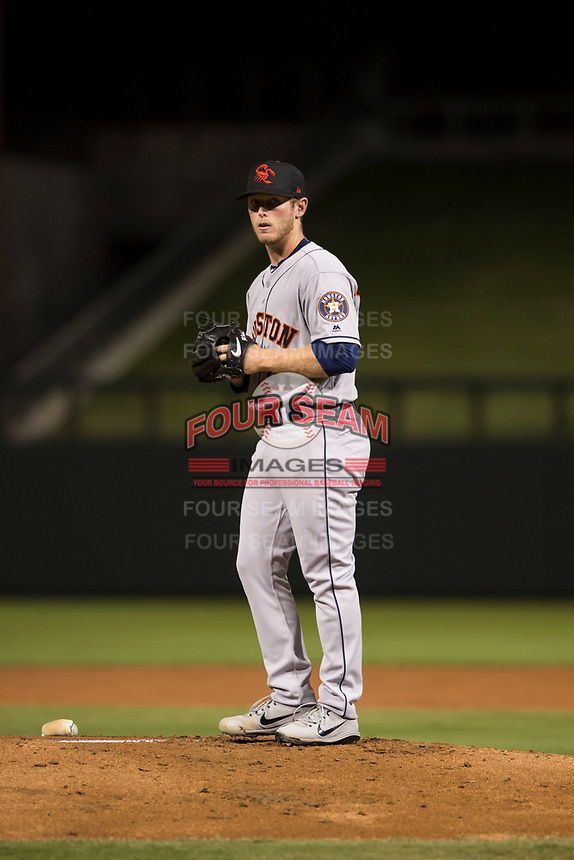 Scottsdale Scorpions relief pitcher J.B. Bukauskas (41), of the Houston Astros organization, gets ready to deliver a pitch during an Arizona Fall League game against the Salt River Rafters at Salt River Fields at Talking Stick on October 11, 2018 in Scottsdale, Arizona. Salt River defeated Scottsdale 7-6. (Zachary Lucy/Four Seam Images)