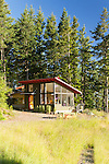 Contemporary cottage tucked into the trees. This image is available through an alternate architectural stock image agency, Collinstock located here: http://www.collinstock.com