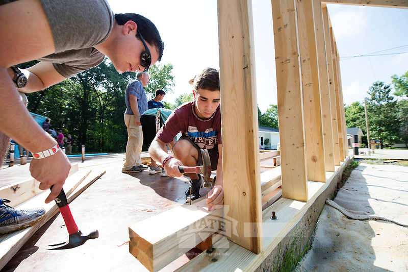 Service DAWGS Day: Freshman MSU student volunteers James Kinnebrew and Jordan Johnson at Habitat for Humanity Maroon Edition house.<br />  (photo by Megan Bean / &copy; Mississippi State University)