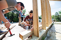 Service DAWGS Day: Freshman MSU student volunteers James Kinnebrew and Jordan Johnson at Habitat for Humanity Maroon Edition house.<br />
