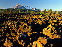 North and Middle Sister from lava field on McKenzie Pass Oregon