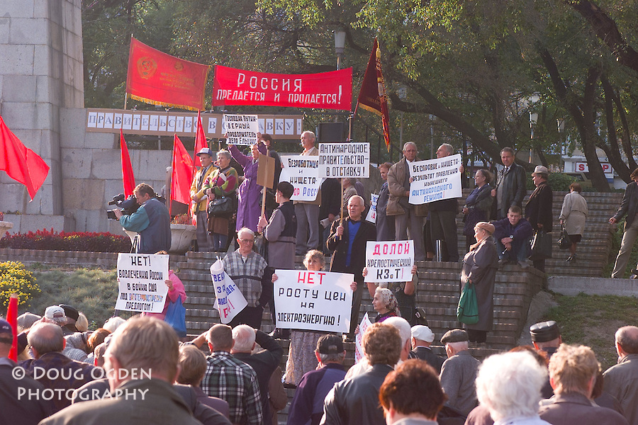 Old Soviet protest at Lenin Square, Signs:  NO INCREASE IN ELECTRICTY PRICES, and ANTI-NATIONAL GOVERNMENT IN RESIGNATION, Vladivostok, Russia