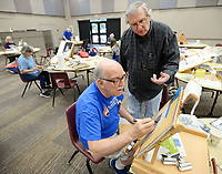 NWA Democrat-Gazette/ANDY SHUPE<br /> Richard Stephens of Hot Springs (right) speaks Wednesday, June 5, 2019, with Victor Parkerson of Fayetteville as he works on a painting of a building during a watercolor class at Sequoyah United Methodist Church in Fayetteville. The four-day workshop, organized by the Artists of Northwest Arkansas, featured a morning lecture by Stephens and an afternoon of supervised painting.
