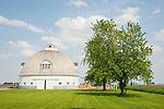 Round white barn, clouds--Raymond Schultz barn built 1918, Pontiac, Ill.