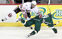 UNO's Tony Turgeon collides with Bemidji State's Drew Fisher. Bemidji State beat UNO 4-2 Friday night during the first round of the WCHA playoffs at Qwest Center Omaha. (Photo by Michelle Bishop)