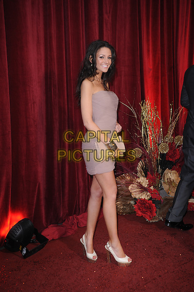 MICHELLE KEEGAN .Attending the British Soap Awards 2010, London Television Centre, London, England, UK, 8th May 2010.arrivals full length beige strapless dress clutch bag peep toe cream shoes platform silver bracelets smiling side .CAP/DS.©Dudley Smith/Capital Pictures