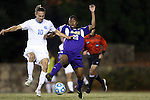 20 November 2014: James Madison's Jamal Umar (20) and North Carolina's Andy Craven (10). The University of North Carolina Tar Heels hosted the James Madison University Dukes at Fetzer Field in Chapel Hill, NC in a 2014 NCAA Division I Men's Soccer Tournament First Round match. UNC won the game 6-0.