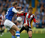 Tom Lees of Sheffield Wednesday challenges David Brooks of Sheffield Utd during the Championship match at the Hillsborough Stadium, Sheffield. Picture date 24th September 2017. Picture credit should read: Simon Bellis/Sportimage