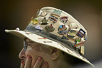 A Gwinnett Stripers usher wears a hat covered in baseball pins during the game against the Scranton/Wilkes-Barre RailRiders at BB&T BallPark on August 17, 2019 in Lawrenceville, Georgia. The Stripers defeated the RailRiders 8-7 in eleven innings. (Brian Westerholt/Four Seam Images)