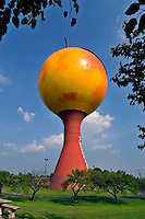 "The """"Peachoid"""" water tower, in Gaffney, South Carolina.  With a capacity of 1 million gallons, the design won the Steel Plate Fabricators Association """"Steel Tank of the Year"""" award, in 1981.  Designed by Peter Freudenberg."