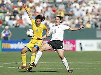 Birgit Prinz (Germany), Jane Toernqvist (Sweden), Germany vs. Sweden in Carson, California on October 12th, 2003.  Germany won 2-1 against Sweden in overtime.