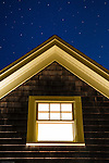 Cottage window at night.
