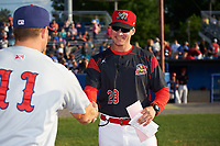 Batavia Muckdogs manager Mike Jacobs (28) shakes hands with Jerad Head (11) during the lineup exchange before a game against the Auburn Doubledays on June 19, 2017 at Dwyer Stadium in Batavia, New York.  Batavia defeated Auburn 8-2 in both teams opening game of the season.  (Mike Janes/Four Seam Images)