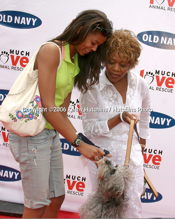 Alfre Woodard and her daughter with their dog.Much Love Animal Rescue Event.Los Angeles, CA.April 29, 2006.©2006 Kathy Hutchins / Hutchins Photo..