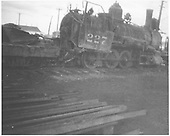 New Mexico Lumber Co. #4 (ex-D&amp;RGS #227) at McPhee following a rollover wreck which killed the fireman.  More information on this wreck is contained in &quot;The RGS Story&quot; Vol. VII on pp. 318-320.<br /> New Mexico Lumber Co.  McPhee, CO  Taken by Long, Morris - after 6/28/1927