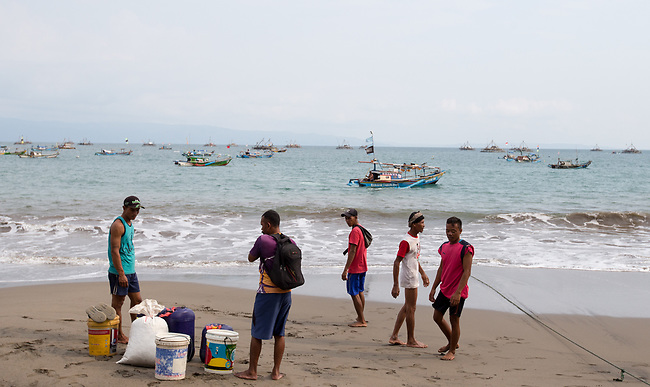 13 February 2019,Pelabuhan Ratu,Sukabumi Regency, West Java, Indonesia. Local fishermen wait for their boat moored off the beach at Cibangban village in West Java. They say that people smugglers have not been active in the area for a long time in the wake of the Australian Government's concern that boats will once again start trafficking people to Australia with the new Medical legislation that has been passed. Picture by Graham Crouch/The Australian