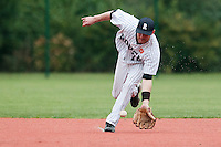 23 October 2010: Aaron Hornostaj of Rouen eyes the ball during Savigny 8-7 win (in 12 innings) over Rouen, during game 3 of the French championship finals, in Rouen, France.