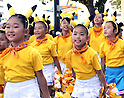 """August 7, 2016, Yokohama, Japan - Little dancers in clad of Pikachu, Nintendo's videogame software Pokemon's wellknown character, parade at a street in Yokohama, suburban Tokyo on Sunday, August 7, 2016. The Pikachu mascots walk around the shoppjng mall daily to attract summer vacationers as a part of the """"Great Pikachu Outbreak"""" event through August 14.    (Photo by Yoshio Tsunoda/AFLO) LWX -ytd-"""