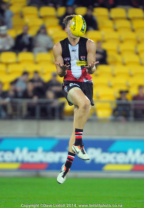 Jack Billings goes up for a mark during the ANZAC Day AFL match between St Kilda Saints and Brisbane Lions at Westpac Stadium, Wellington, New Zealand on Friday, 25 April 2014. Photo: Dave Lintott / lintottphoto.co.nz