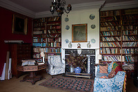 A more modest library tucked away at Tullynally is furnished with floor-to-ceiling bookcases and a small sofa and chair