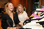 Katherine Phelps and Kathryn Painter browse at a cocktail party at the home of Becca Cason Thrash featuring a trunk show from Christos Garkinos, owner of the L.A. boutique Decadestwo Wednesday April 21,2010.. (Dave Rossman Photo)