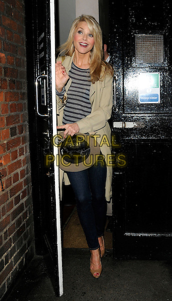 """CHRISTIE BRINKLEY departed after the  evening performance in """"Chicago"""", Cambridge theatre, London, England..July 19th, 2011.full length jeans denim beige peep toe shoes mac black grey gray striped stripes top hat mouth open door.CAP/CAN.©Can Nguyen/Capital Pictures."""