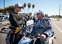 Feb 11, 2019; Pomona, CA, USA; NHRA funny car driver John Force (right) talks with driver Austin Prock during the Winternationals at Auto Club Raceway at Pomona. Mandatory Credit: Mark J. Rebilas-USA TODAY Sports