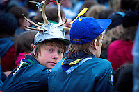 Boys wearing unique hats during the opening ceremony.