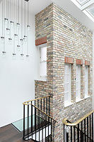 The exposed wall of the stairwell looks is a huge architectural feature of the house