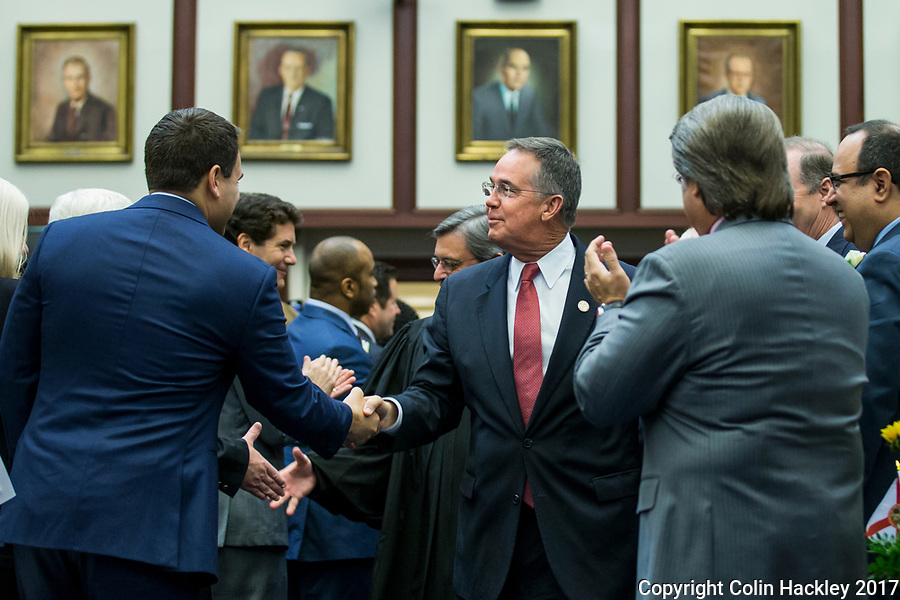 TALLAHASSEE, FLA. 3/7/17-Chief Financial Officer Jeff Atwater, center, is greeted as he enters the House Chamber for his final opening day as CFO, Tuesday at the Capitol in Tallahassee. Atwater is stepping down as CFO after the session to take a post at Florida Atlantic University.<br /> <br /> COLIN HACKLEY PHOTO