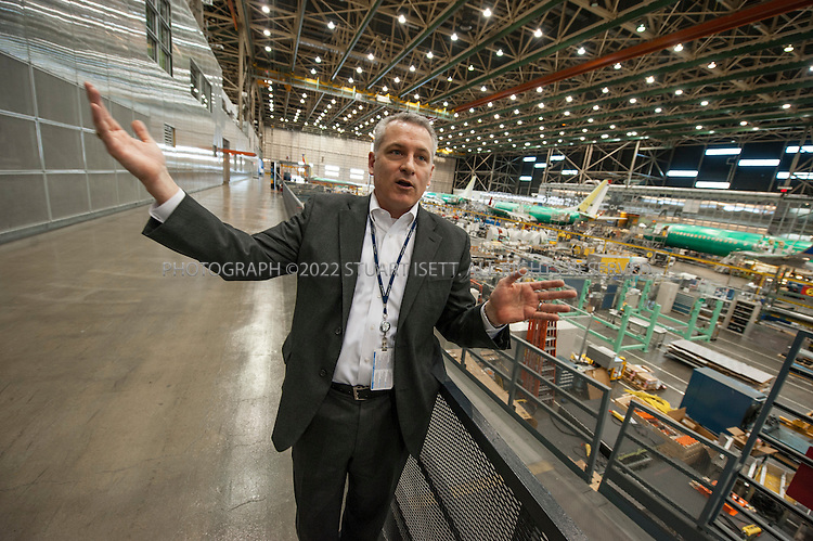 3/6/2012--Renton, WA, USA..Erik Nelson, deputy operations leader for the 737 program, explains the production of the aircraft. Behind Boeing 737s lined up for the final assembly run at the Boeing plant in Renton, WASH., south of Seattle. The 737 series is the best-selling jet airliner in the history of aviation with plans for a new versions, the 737-Max starting production in 2017...©2012 Stuart Isett. All rights reserved