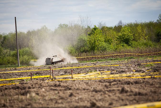 Donji Rahić. MV-4 mine-clearance vehicle in field.