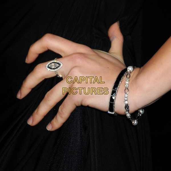 """MILA KUNIS' hand .at Alcon Entertainment's L.A. Premiere of """"The Book of Eli"""" held at The Chinese Theatre in Hollywood, California, USA, January 11th 2010. .hand ring bracelets .CAP/ADM/BP.©Byron Purvis/AdMedia/Capital Pictures."""