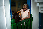 "Maria, owner of the ""Patio de Maria"" coffee bar, and one of the old inhabitants of the eco-village  Las Terrazas, founded in 1968 by the government as an ecological experiment to revitalize the poor province of Pinar del Rio. Today the ambitious project stands out as a unique example of an eco tourist resort in Cuba."