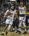 Nevada forward Caleb Martin (10) dribbles around a screen set by forward Trey Porter (15) against Akron in the first half of an NCAA college basketball game in Reno, Nev., Saturday, Dec. 22, 2018. (AP Photo/Tom R. Smedes)