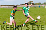 Ballyduff's Mikey O'Halloran gets the ball away ahead of Moyvane's Evan Flavin in their 1st round clash in the Bernard O'Callaghan Memorial Senior Football North Kerry Championship sponsored by McMunns Bar & Restaurant in Ballyduff on Saturday last