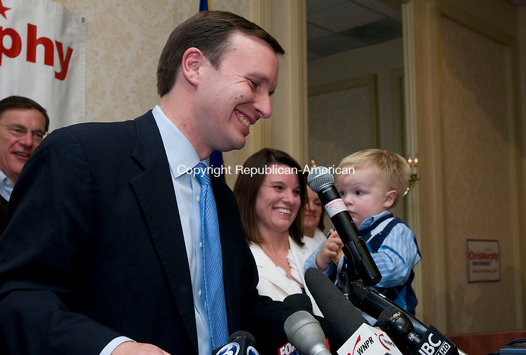 WATERBURY, CT-02 NOVEMBER, 2010-110210S04-Rep. Christopher S. Murphy, D-5th District smiles during his victory speach Tuesday at  election headquarters at the Holiday Inn in Waterbury. <br /> Jim Shannon Republican-American