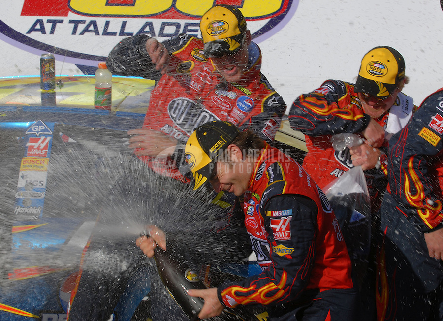 Apr 29, 2007; Talladega, AL, USA; Nascar Nextel Cup Series driver Jeff Gordon (24) celebrates with his team after winning the Aarons 499 at Talladega Superspeedway. Mandatory Credit: Mark J. Rebilas