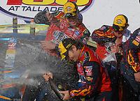 Apr 29, 2007; Talladega, AL, USA; Nascar Nextel Cup Series driver Jeff Gordon (24) celebrates with his team after winning the Aarons 499 at Talladega Superspeedway. Mandatory Credit: Mark J. Rebilas