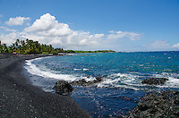 Looking south along the mostly black sand beach of Keawaiki Bay, north of Kona, Hawai'i Island; an 1859 eruption of Mauna Loa flowed into this area, which was also the site of an ancient Hawaiian settlement and temple (or heiau).