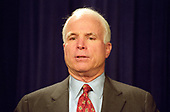United States Senator John McCain (Republican of Arizona) meets reporters after his and US Senator Russ Feingold's (Democrat of Wisconsin) proposal to overhaul the nation's campaign finance laws fell due to a Republican filibuster for the fourth straight year in the US Capitol in Washington, DC on October 19, 1999.  The bill would have banned soft money and would have allowed nonunion members to stop labor unions from spending their mandatory dues on political activities.<br /> Credit: Ron Sachs / CNP