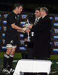 NZRU President Andy Leslie hands All Blacks Captain Reuben Thorne the Trakker Cup after the Iveco rugby union international test match between the All Blacks and Canada at Waikato Stadium, Hamilton, New Zealand on Saturday 16 June 2007. The All Blacks won the match 64 - 13.