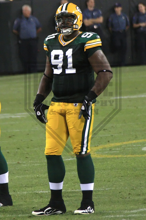 GREEN BAY - AUGUST 2010: Justin Harrell (91) of the Green Bay Packers during a game on August 14, 2010 at Lambeau Field in Green Bay, Wisconsin. (Photo by Brad Krause)